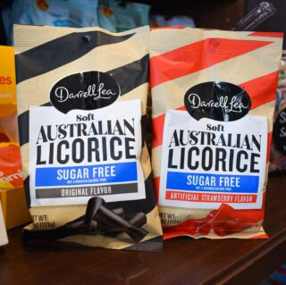 """A lot of you ask if the """"Aus"""" is AusSam stands for Australia… It doesn't, but we'll make an exception for this photo😜❤️  This week's #WishListWednesday featured item is our #NEW Australian Licorice. And the best part, is it's Sugar Free😍  Drop a comment below of the candy you want to see in store! ⬇️"""