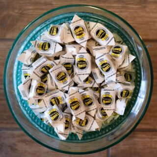 #NationalCoffeeDay 🤍💛🤎 and an AusSam Candy Fan Favorite 😋 These delicious treats are made by one of the oldest candy companies in Holland!  One evening, the candy maker left his cup of coffee, sugar and cream on the stove. The next morning it had become a caramel😜